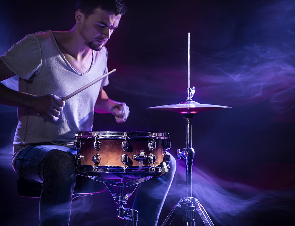 musician playing a snare drum