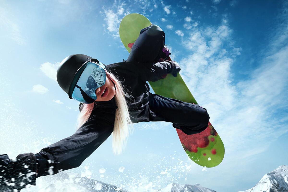 woman snowboarding upside down