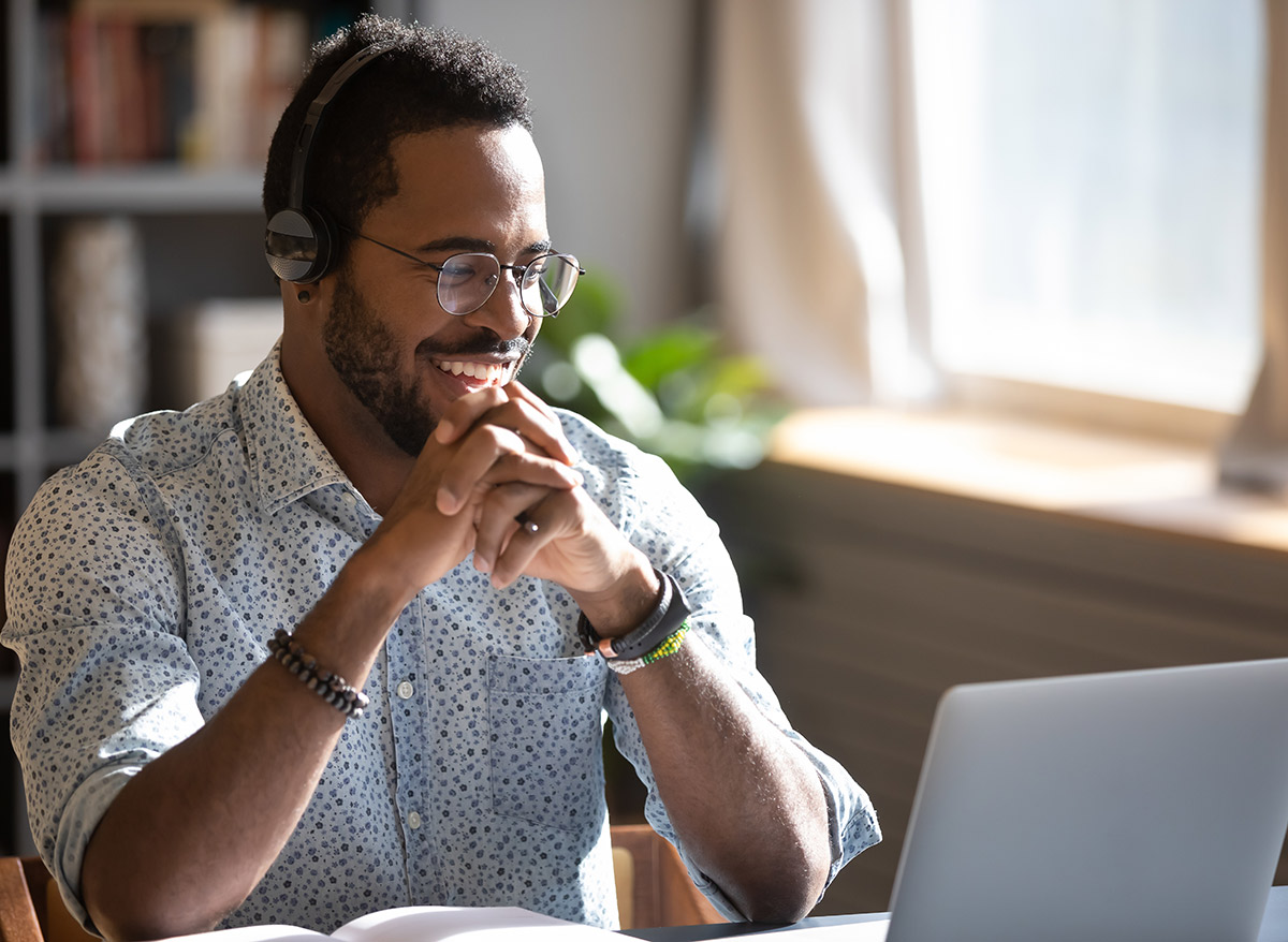 smiling man on a conference call