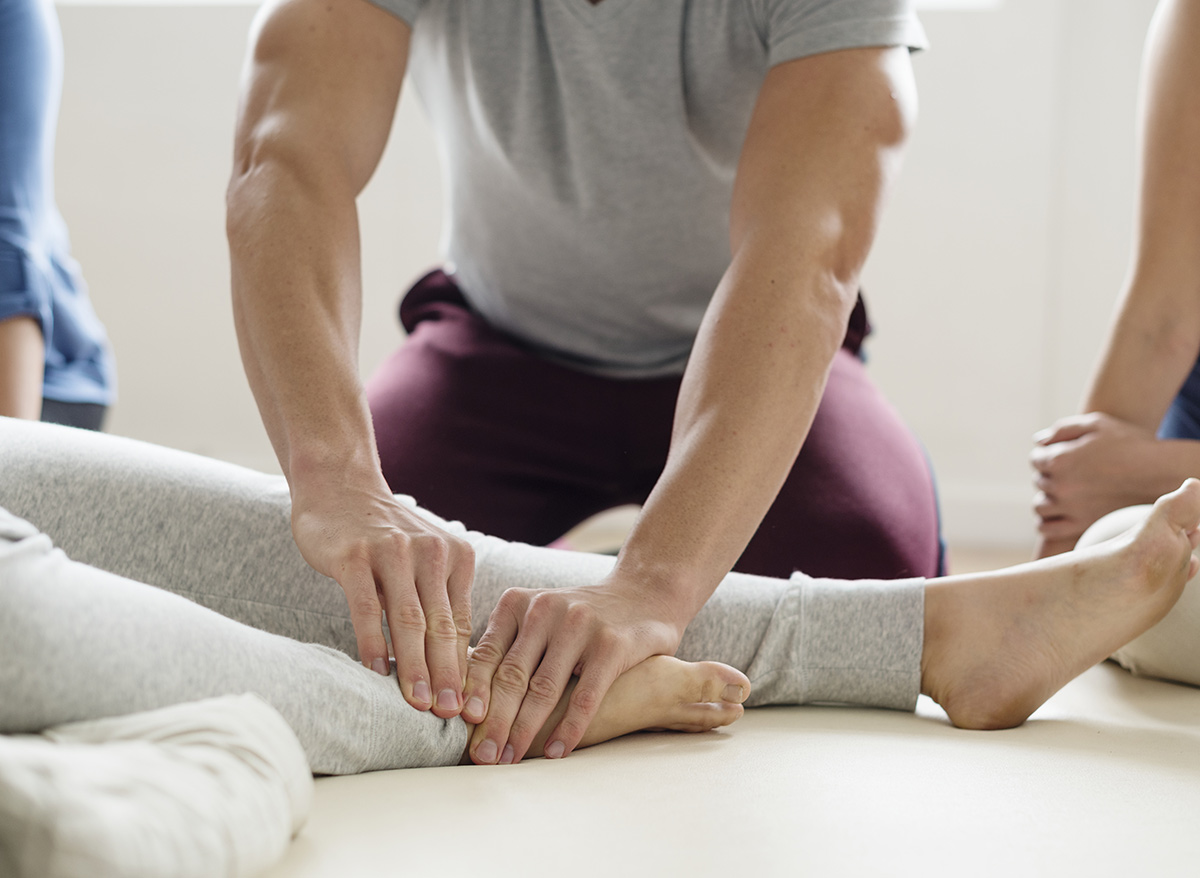 manual therapist working on a client's foot