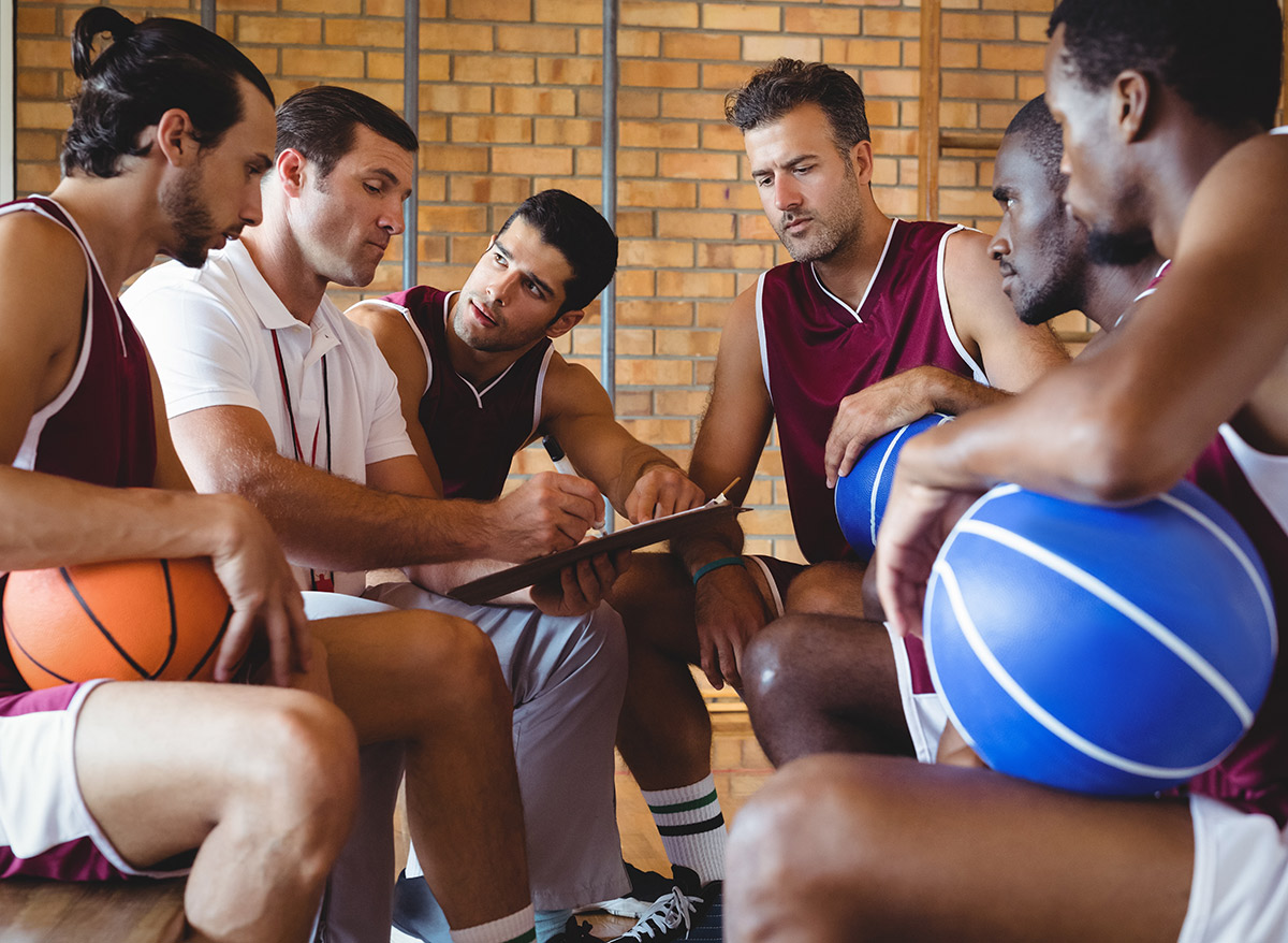 basketball coach talking to the team of players