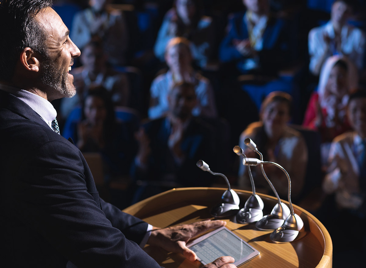 man public speaking at a lecture